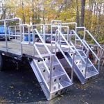 Retrofit truck bed with aluminum railings and stairs